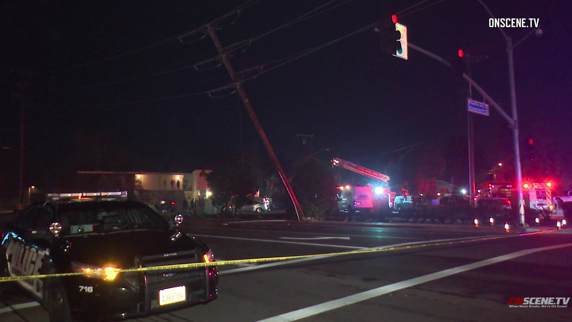 A utility pole is seen leaning following a fatal SUV crash in Costa Mesa on Dec. 8, 2018. (Credit: Onscene.tv)