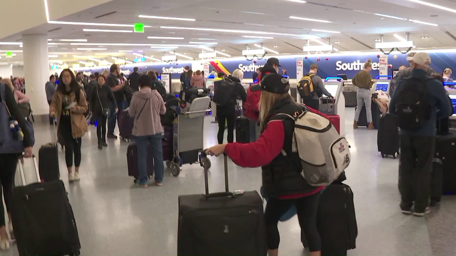 Children and surviving spouses of fallen U.S. military heroes gather at the Los Angeles International Airport before heading to Disney World on Dec. 8, 2018. (Credit: KTLA)