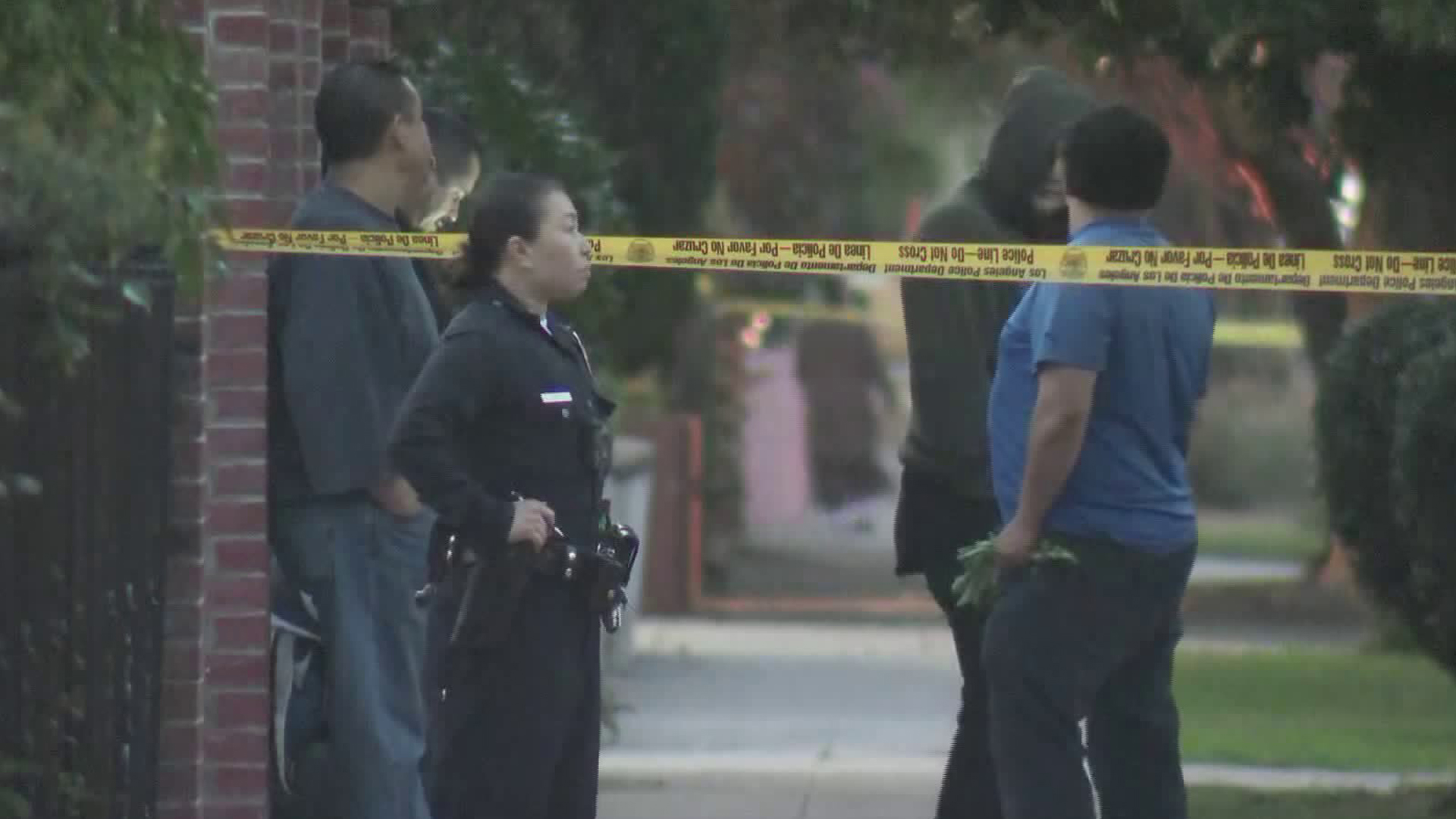 Investigators seen at the scene of a stabbing in Hollywood on Jan. 30, 2019. (Credit: KTLA)