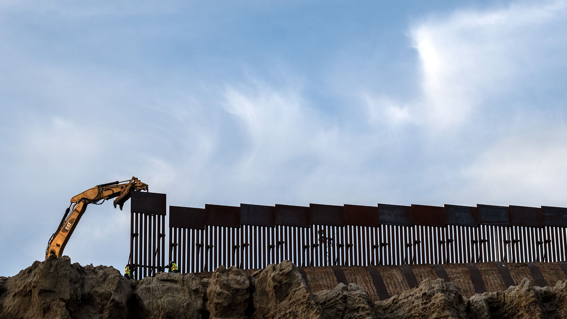 A crew works replacing the old border fence along a section of the U.S.-Mexico border, as seen from Tijuana, in Baja California state, Mexico, on Jan. 8, 2019. (Credit: GUILLERMO ARIAS/AFP/Getty Images)