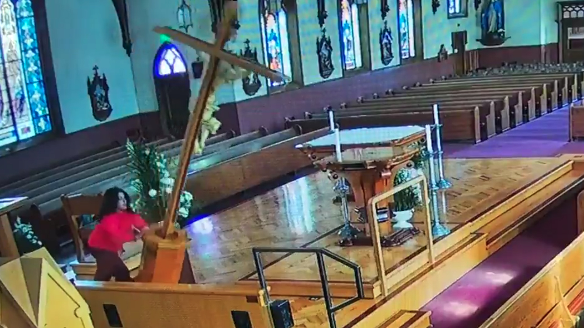 A woman is seen vandalizing a church in Watsonville, in this still from footage released by local police on Feb. 7, 2019.