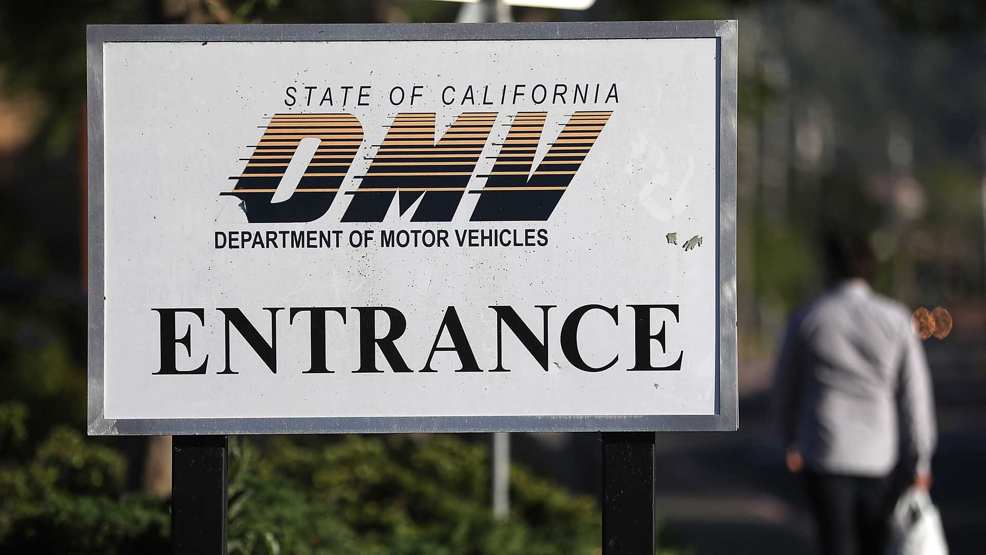 A sign is posted in front of a California Department of Motor Vehicles (DMV) office on May 9, 2017 in Corte Madera. (Credit: Justin Sullivan/Getty Images)