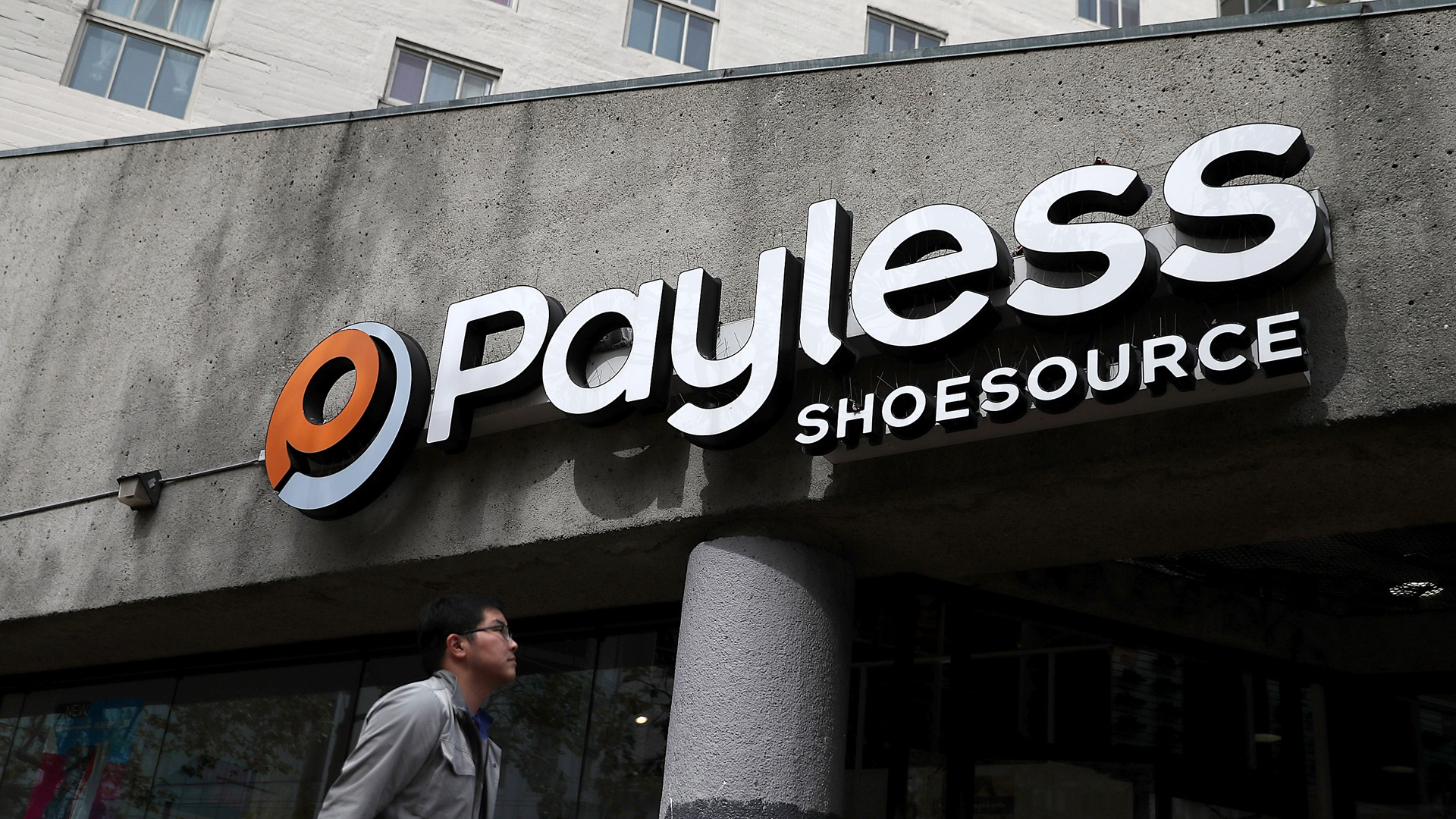 A pedestrian walks by a Payless Shoe Source store on April 5, 2017 in San Francisco. (Credit: Justin Sullivan/Getty Images)