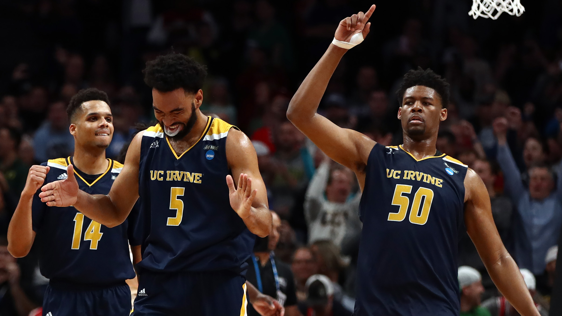 Jonathan Galloway #5 and Evan Leonard #14 and Elston Jones #50 of the UC Irvine Anteaters celebrate a win against the Kansas State Wildcats for their first school tournament win during the first round of the 2019 NCAA Men's Basketball Tournament at SAP Center on March 22, 2019, in San Jose. (Credit: Ezra Shaw/Getty Images)