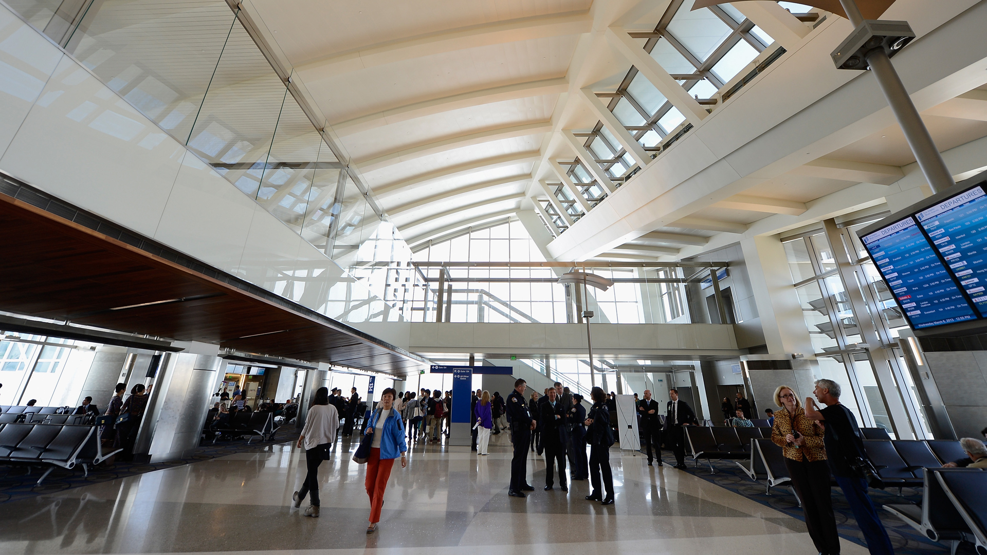 People walk through the north concourse of Tom Bradley International Terminal during its unveiling at Los Angeles International Airport on March 6, 2013. (Credit: Kevork Djansezian/Getty Images)