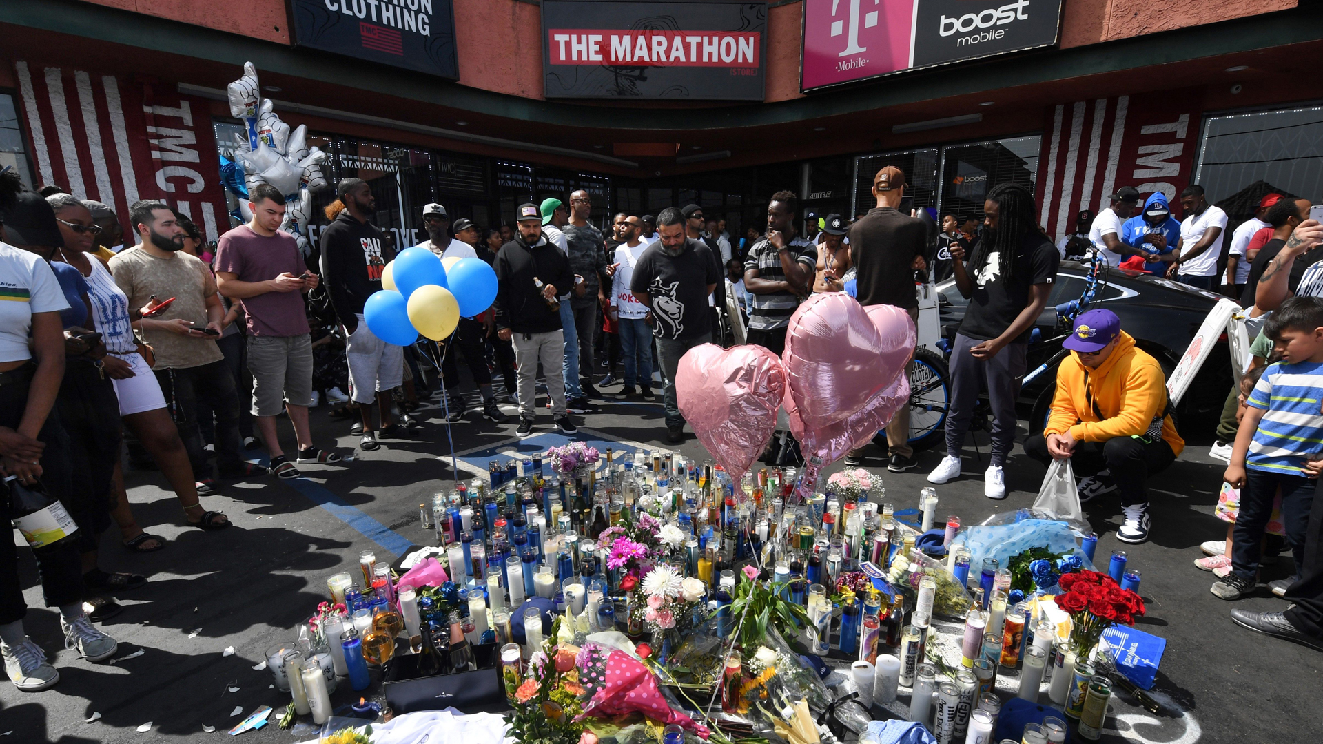 Fans pay their respects at a makeshift memorial outside The Marathon clothing store owned by Grammy-nominated rapper Nipsey Hussle where he was fatally shot along with 2 other wounded in Los Angeles.(Credit: MARK RALSTON/AFP/Getty Images)