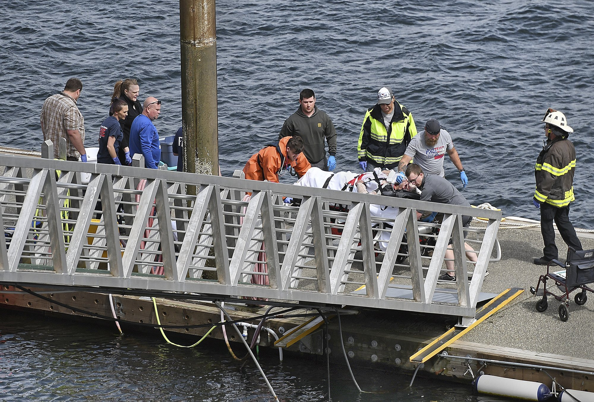 Emergency personnel transport an injured passenger to an ambulance in Ketchikan, Alaska, after two float planes collided in flight on May 13, 2019. (Credit: Dustin Safranek / AP via CNN)