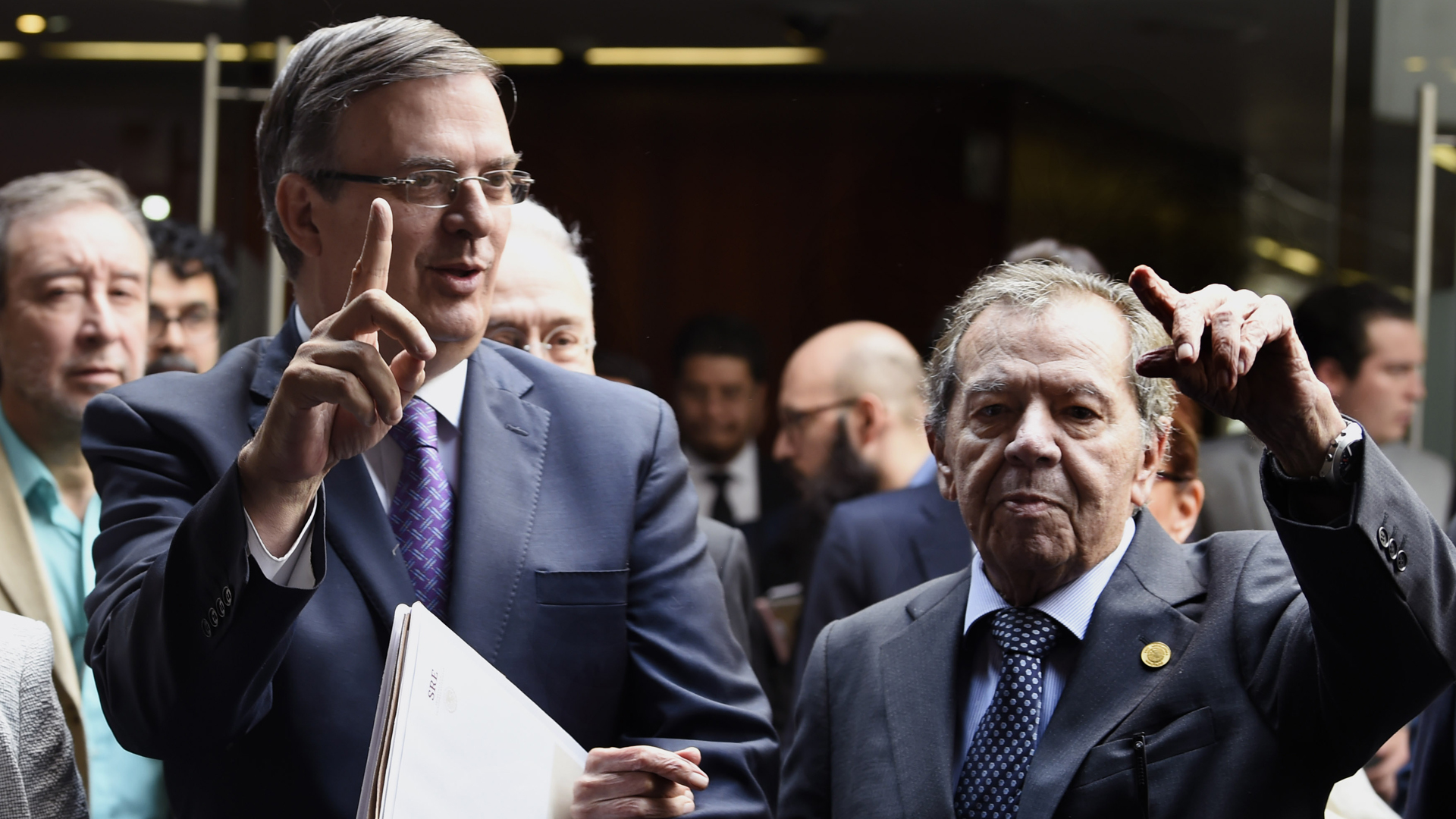 Mexican Foreign Minister Marcelo Ebrard (L) arrives to the Mexican Senate accompanied by the President of the Mexican Congress Porfirio Munoz Ledo, to brief legislators on the US-Mexico migration deal on June 14, 2019. (Credit: Alfredo Esrella/AFP/Getty Images)
