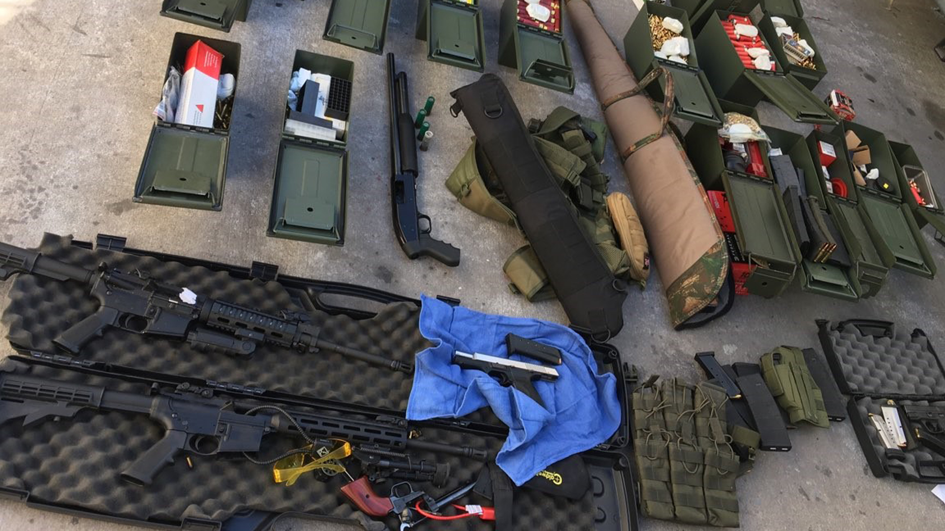 Police released this photo of the weapons seized in the arrest of a man accused of threatening a mass shooting at a hotel in Long Beach.