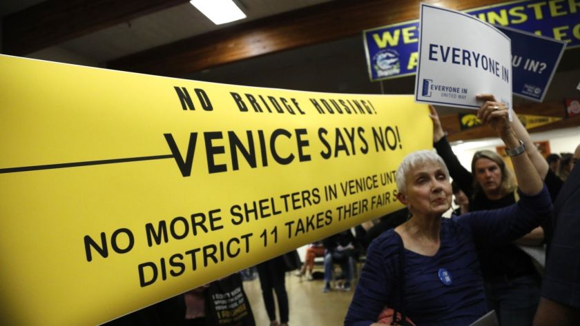 Neighbors both for and against a planned homeless shelter in Venice attend an open house at Westminster Elementary School in June 2019. (Credit: Genario Molina / Los Angeles Times)