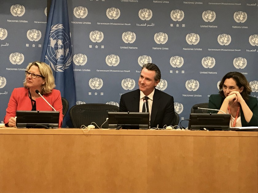 Gov. Gavin Newsom speaks at a news conference at the United Nations in New York City with Svenja Schulze of Germany, left, and Barcelona Mayor Ada Colau on Sept. 23, 2019. (Credit: Taryn Luna / Los Angeles Times)