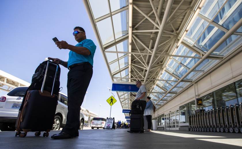 A traveler at Ontario International Airport waits for his Uber in this undated photo. (Credit: Allen J. Schaben/Los Angeles Times)