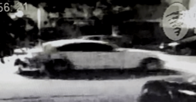 A white sedan suspected of being involved in a fatal hit-and-run collision in Garden Grove on Sep. 1, 2019, is seen in surveillance video provided by the Garden Grove Police Department.