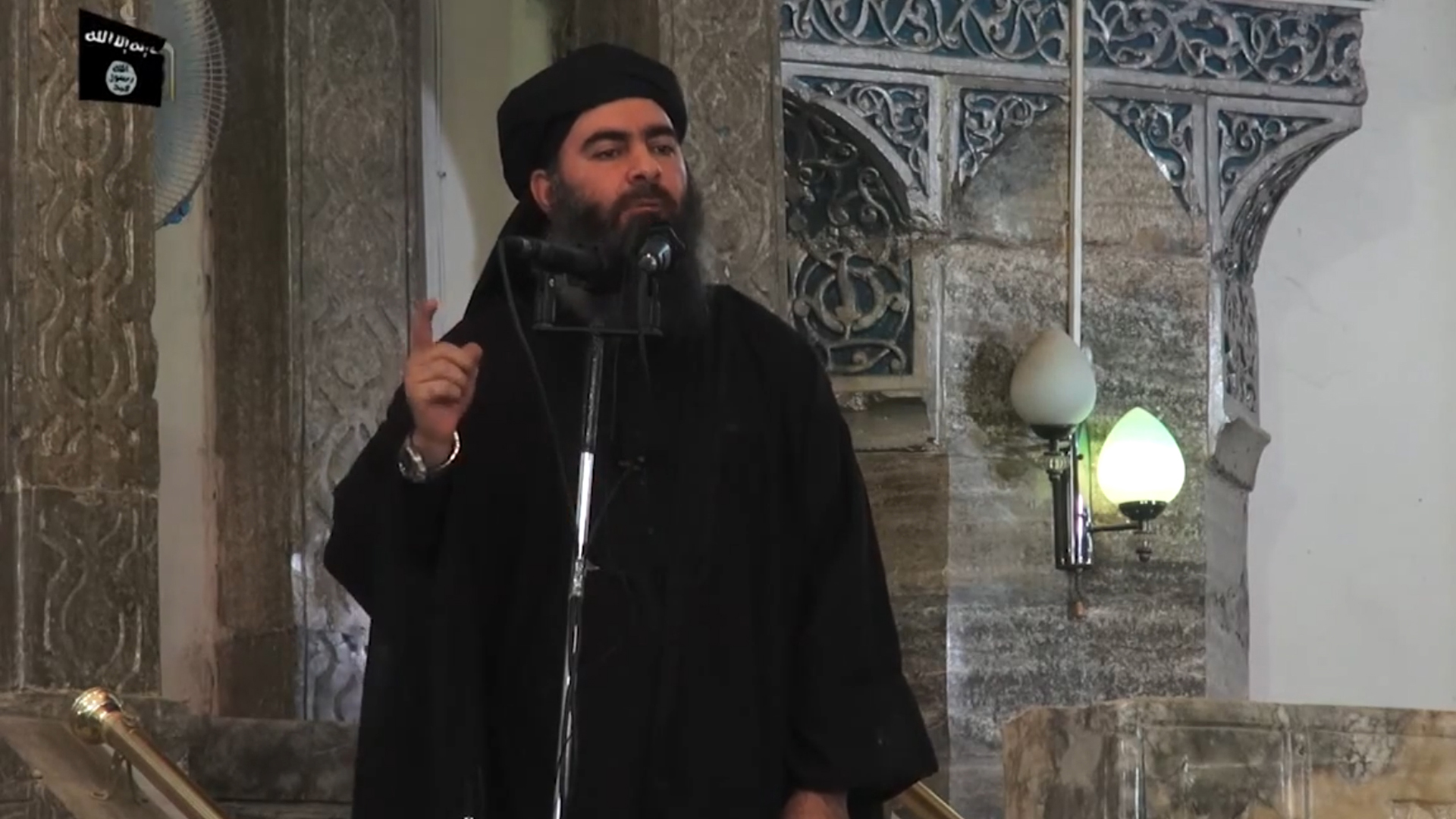 In this file picture taken on July 5, 2014, an image grab taken from a propaganda video released by al-Furqan Media allegedly shows the leader of the Islamic State (IS) jihadist group, Abu Bakr al-Baghdadi, aka Caliph Ibrahim, addressing Muslim worshippers at a mosque in the militant-held northern Iraqi city of Mosul. (Credit: AFP/Getty Images)