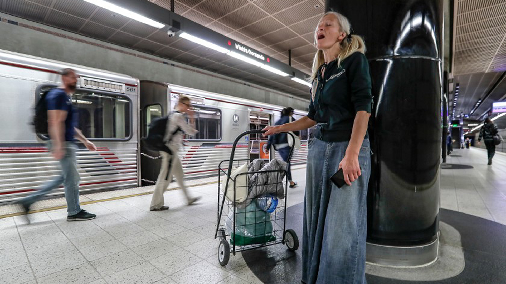 Emily Zamourka sings in a subway station in Koreatown.(Credit: Robert Gauthier / Los Angeles Times)