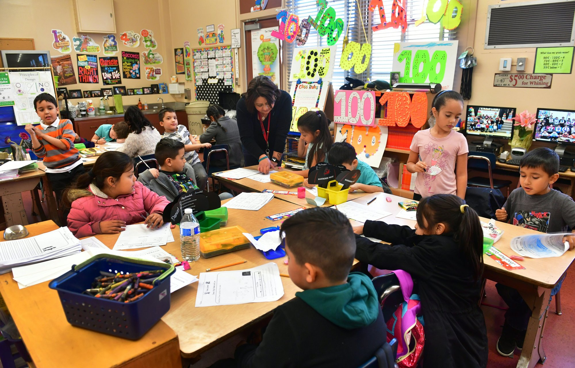 Telfair Elementary School first grade teacher Ms. Gutierrez works with her students on Feb. 8, 2019, in Pacoima. (Credit: FREDERIC J. BROWN/AFP/Getty Images)