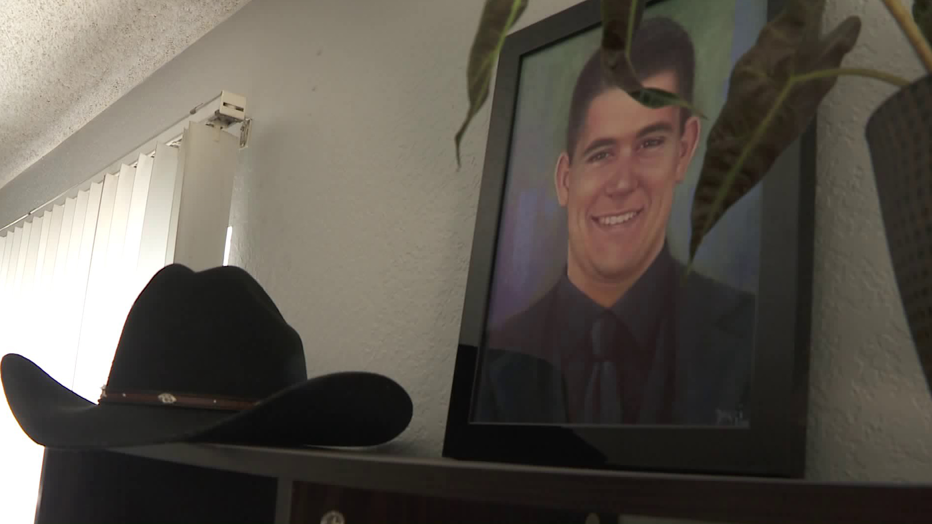 Cody Coffman appears in a photo displayed in his family's living room a year after he died in the 2018 Borderline Bar & Grill mass shooting in Thousand Oaks. (Credit: KTLA)