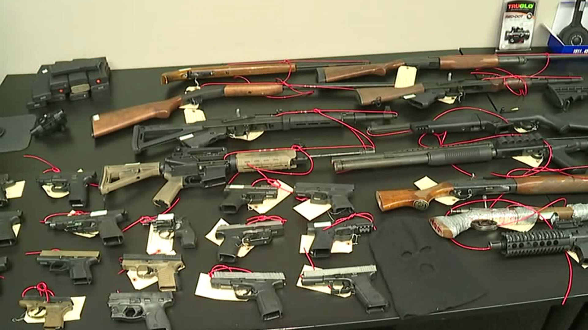 Some of the confiscated firearms in a gang takedown in Stockton are seen at a news conference on Nov. 19, 2019. (Credit: KTXL)