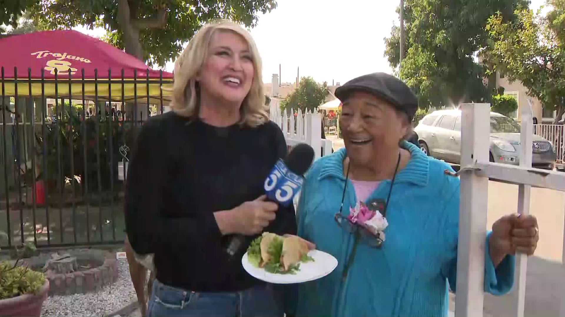 """Parents of Watts' """"Sweet Alice"""" Harris offered residents turkeys and tacos for the advocacy group's annual Thanksgiving giveaway on Nov. 26, 2019. (Credit: KTLA)"""