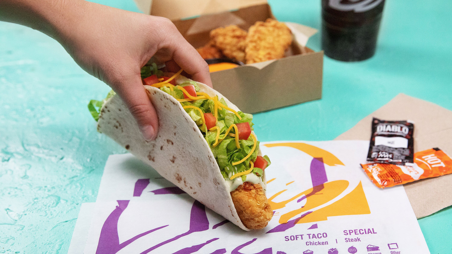 The Texmex chain's fried, spicy Crispy Tortilla Chicken isn't enjoyed between two buns, but it can be rolled up in a taco. (Credit: Taco Bell)