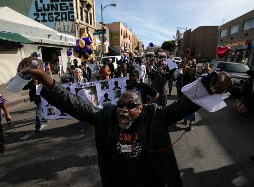 Pancake, a community organizer, leads supporters as they march in downtown Los Angeles on Dec. 21, 2019, in tribute to homeless people in Los Angeles County who died during the year. (Credit: Jason Armond / Los Angeles Times)