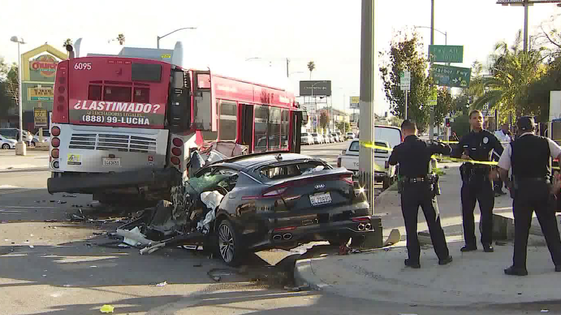 Los Angeles police investigate the scene in Florence where a car collided with a passenger bus on Dec. 30, 2019. (Credit: KTLA)