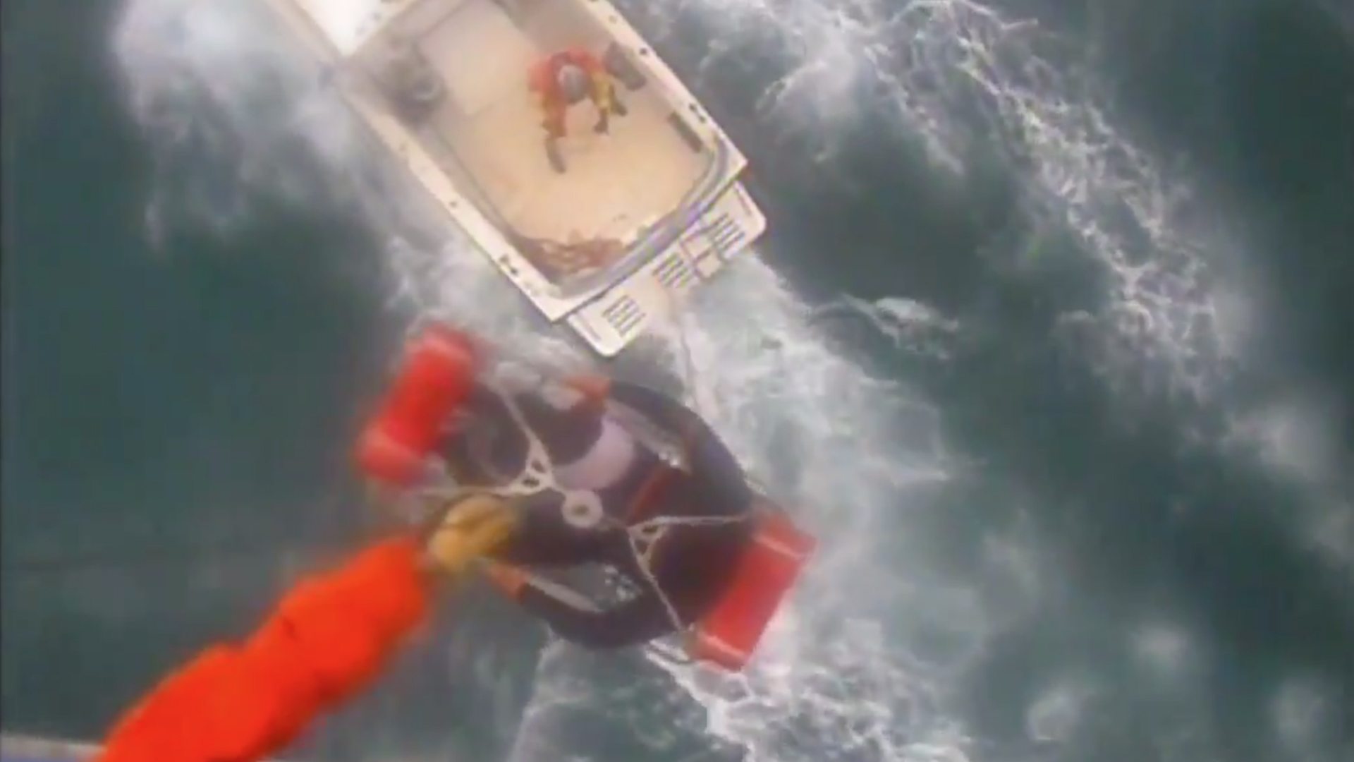 A U.S. Coast Guard crew hoists a shark bite victim into a helicopter near Santa Rosa Island on Dec. 21, 2019. (Credit: USCG)