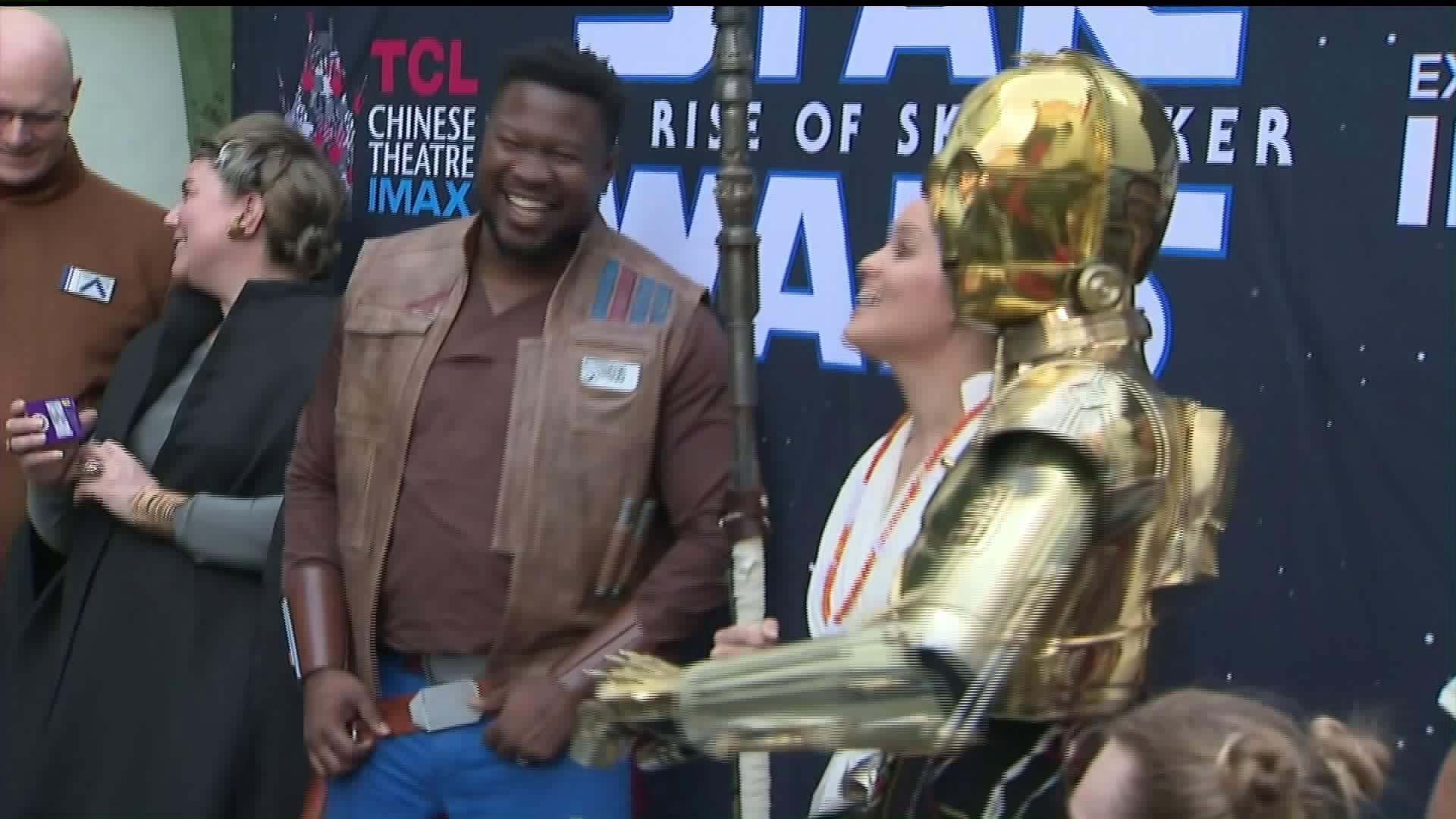 "Fans gather for the release of ""Star Wars: The Rise of Skywalker"" in Hollywood on Dec. 19, 2019. (Credit: KTLA)"
