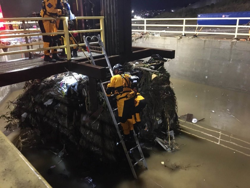 San Diego Fire Rescue worked with Border Patrol to rescue dozens of people from a drainage tube about 2 miles west of the San Ysidro Port of Entry on Nov. 28, 2019. (Credit: U.S. Border Patrol via Los Angeles Times)