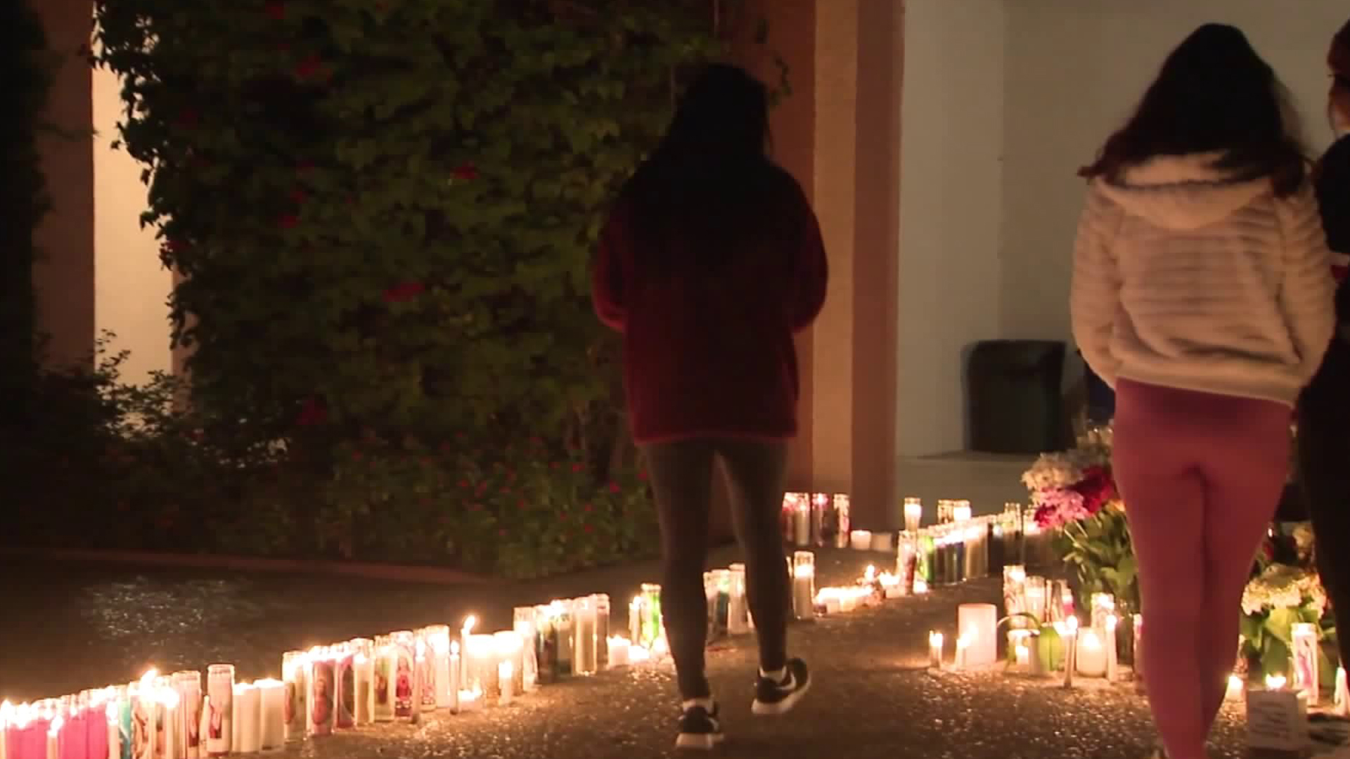 Students at Damien High School in La Verne attend a vigil on Dec. 15, 2019, for Tim Staples, a teacher there who died a day earlier while taking part in the search for a missing hiker on Mount Baldy. (Credit: KTLA)