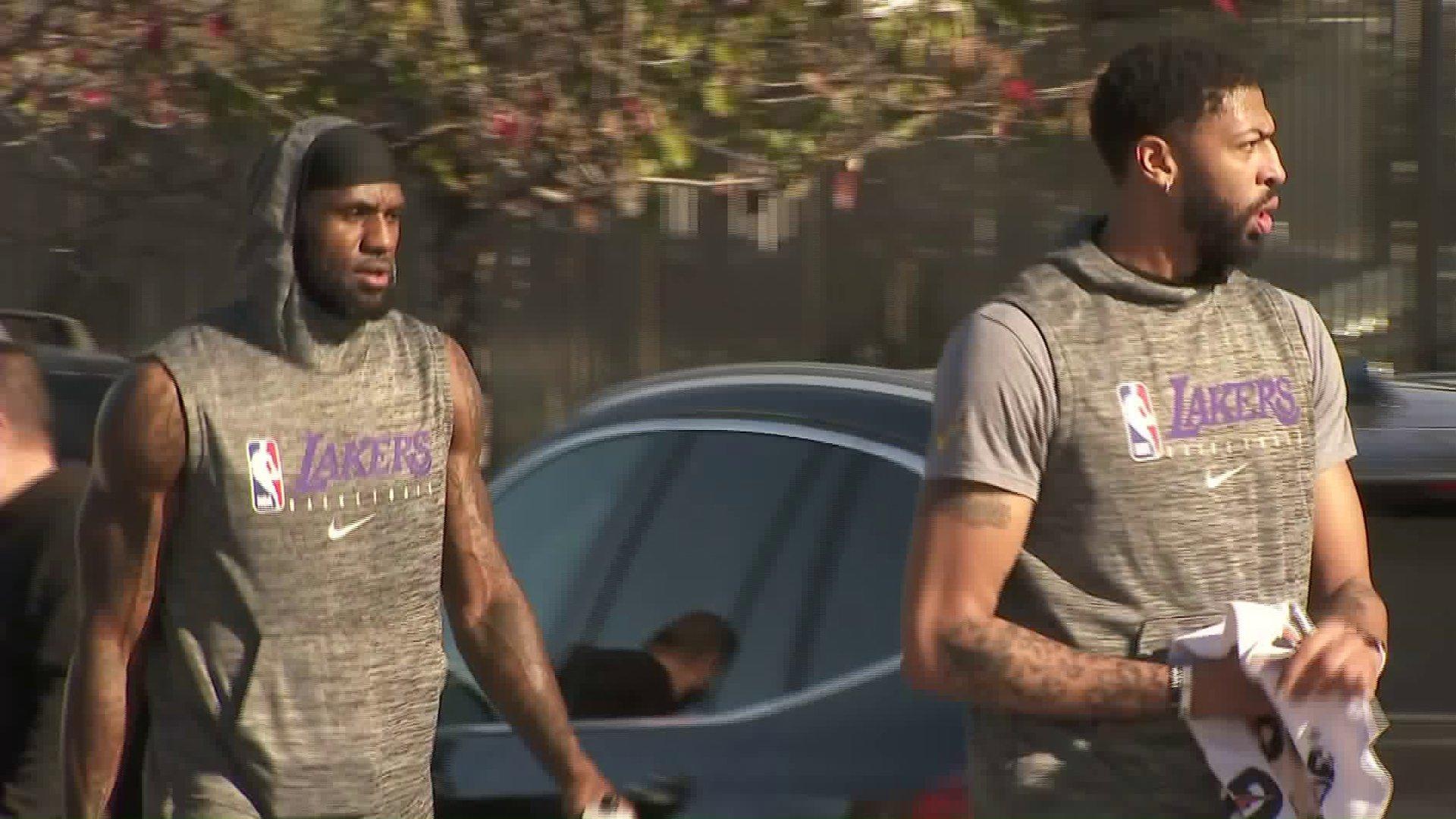 LeBron James, left, and Anthony Davis walk to the Los Angeles Lakers' practice facility in El Segundo on Jan. 29, 2020. (Credit: KTLA)