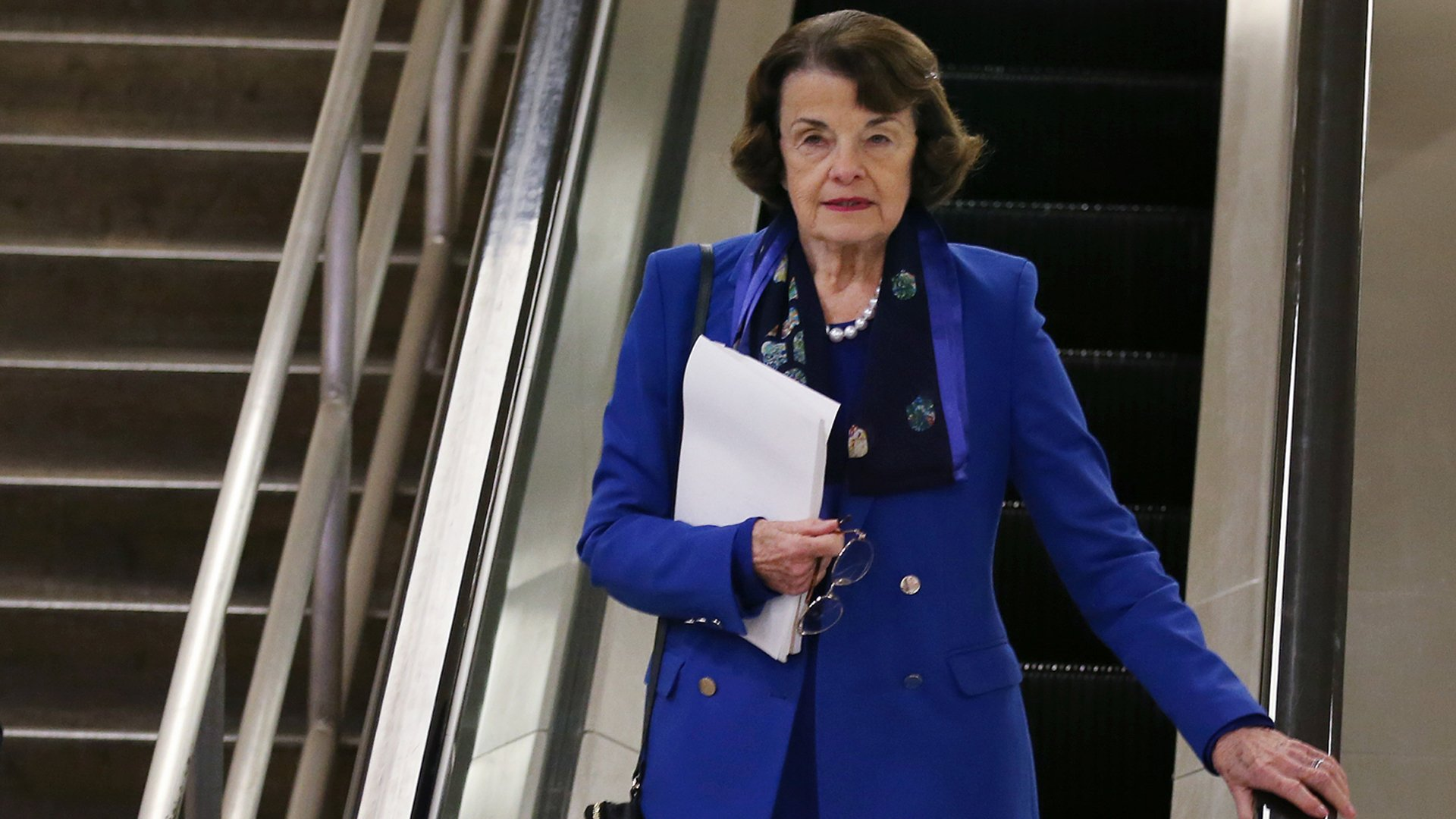 Sen. Dianne Feinstein descends an escalator at the U.S. Capitol after the Senate impeachment trial adjourned for the day on Jan. 28, 2020. (Credit: Mario Tama / Getty Images)