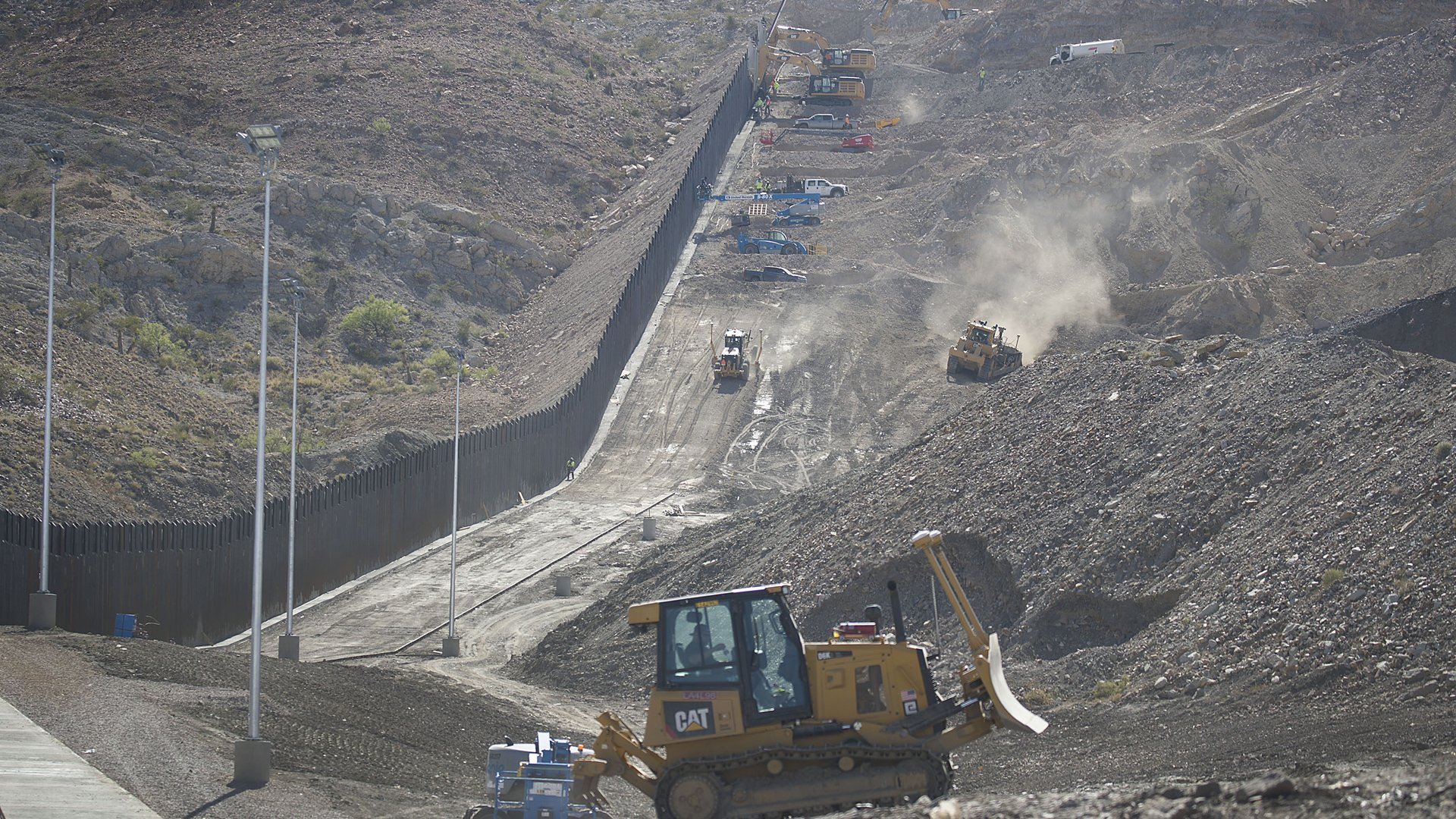 Construction crews work on a border wall being put in place by the We Build The Wall Inc. non-profit on June 1, 2019, in Sunland Park, New Mexico. (Credit: Joe Raedle/Getty Images)