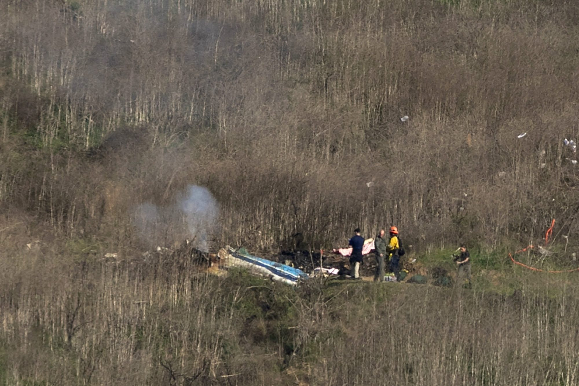Investigators work at the scene of a helicopter crash that killed former NBA star Kobe Bryant on Jan. 26, 2020, in Calabasas. (Credit: David McNew/Getty Images)