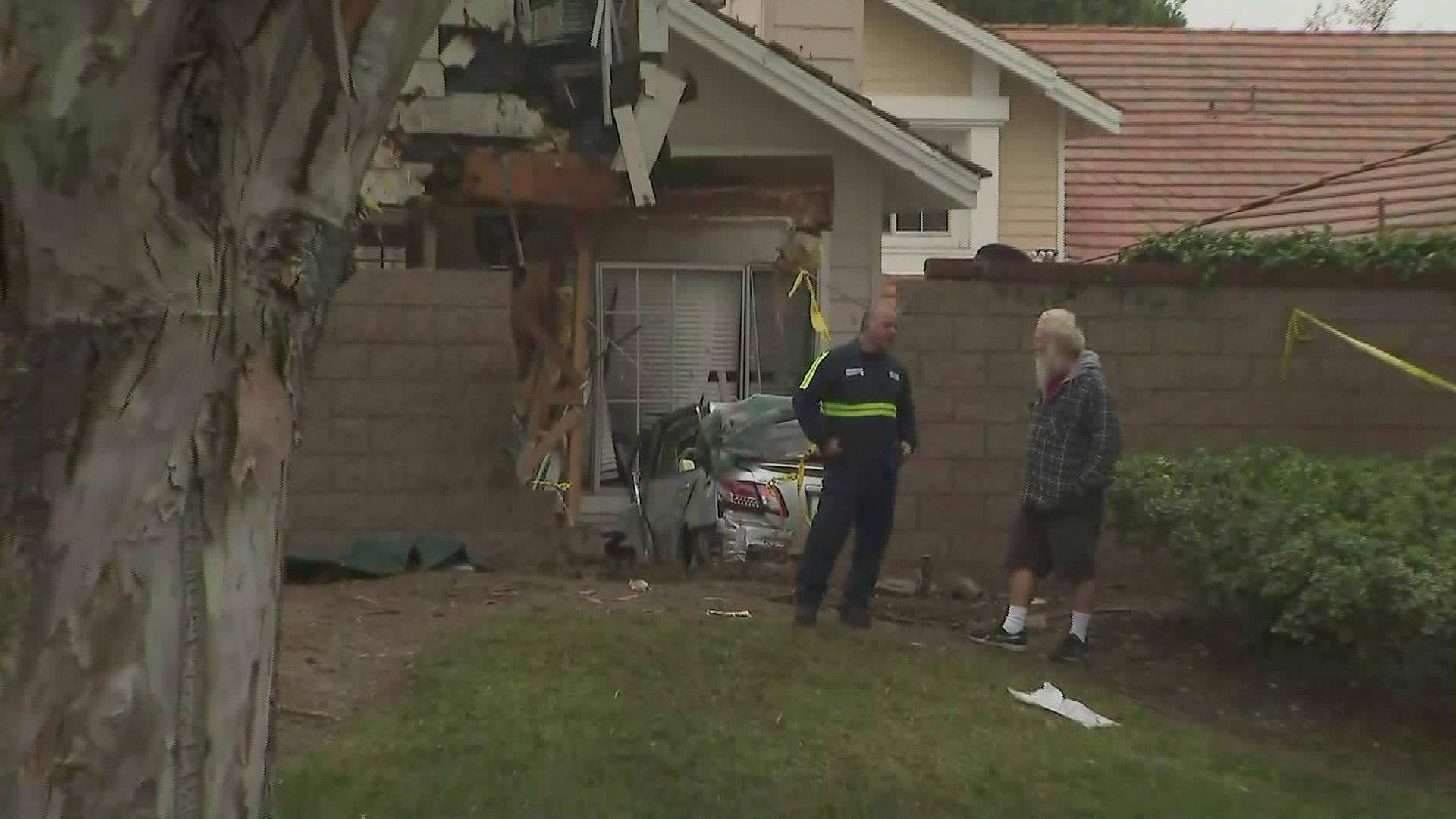 A car plowed into a Tustin home on Jan. 25, 2020. (Credit: KTLA)