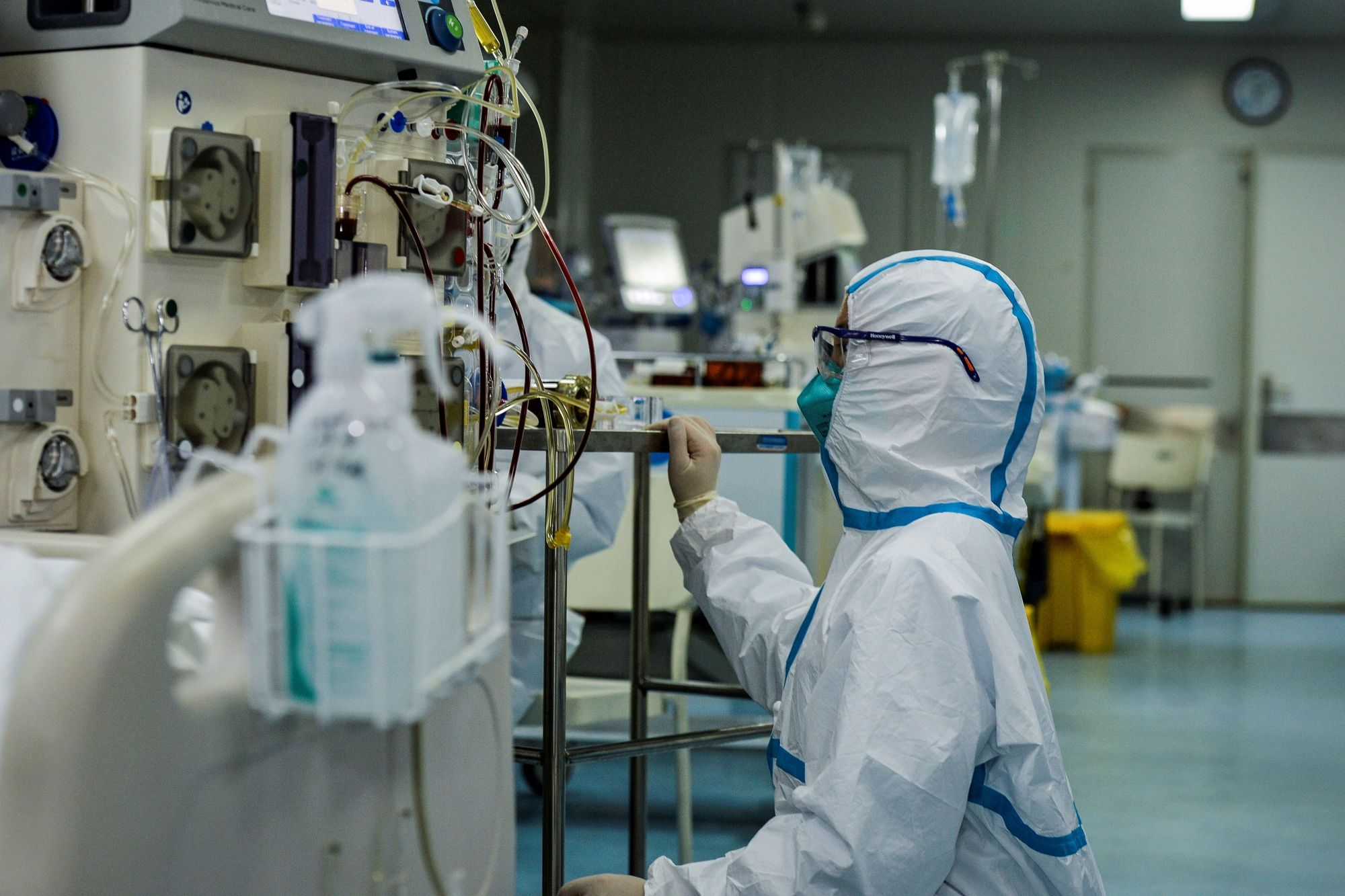 A doctor operates a machine as medical staff treat patients infected with the COVID-19 coronavirus at a hospital in Wuhan in China's central Hubei province on Feb. 24, 2020. (STR/AFP via Getty Images)