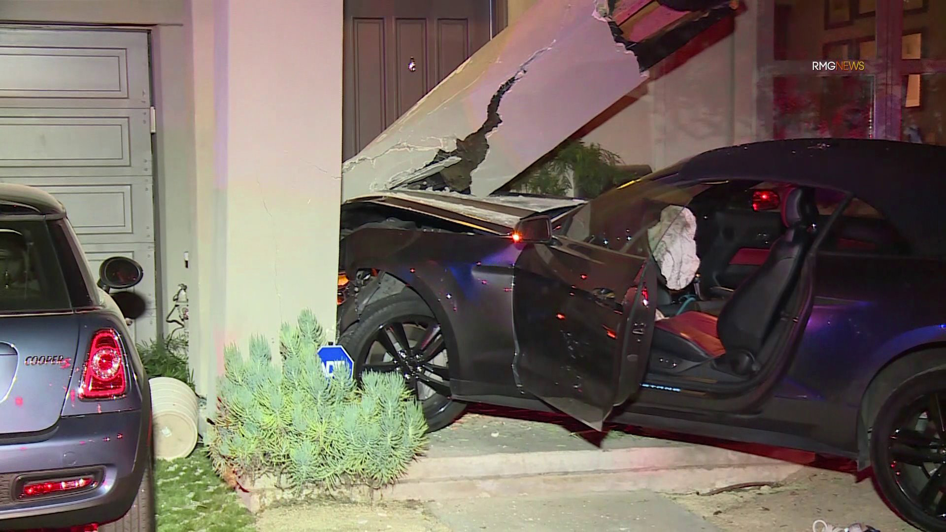 A Ford Mustang crashed into a West Hollywood home on Feb. 26, 2020. (RMG News)