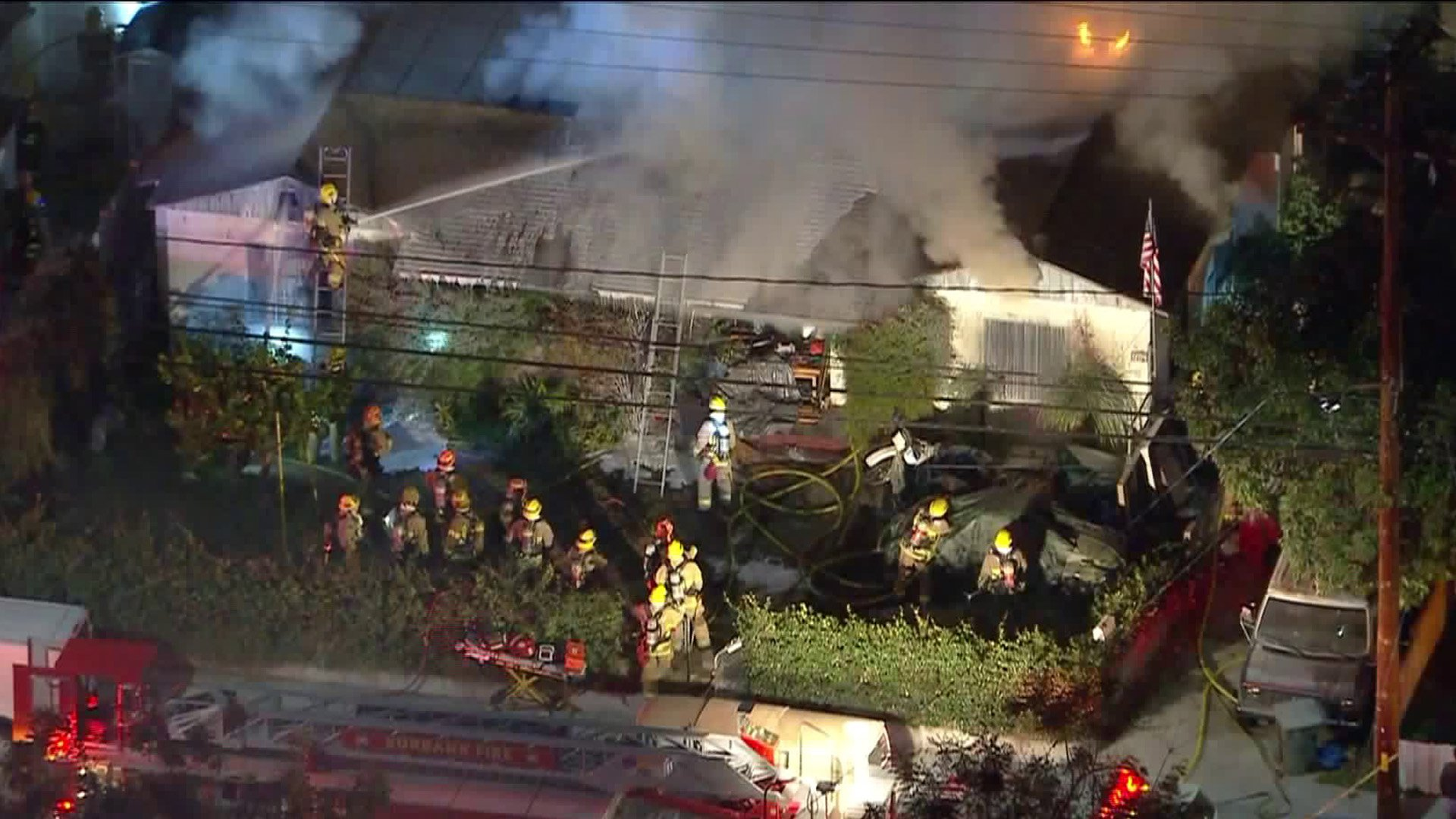 Sky5 footage shows firefighters putting out a fire at a home located at 1204 South Lake St. in Burbank on Feb. 13, 2020. (Credit: KTLA)