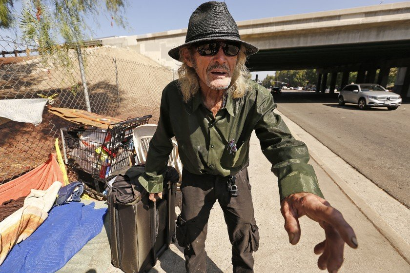 Rex Schellenberg, a homeless man who is suing the city of Los Angeles, is seen at a site where he was living on Topanga Canyon Boulevard in Woodland Hills in 2018. (Credit: Al Seib / Los Angeles Times)