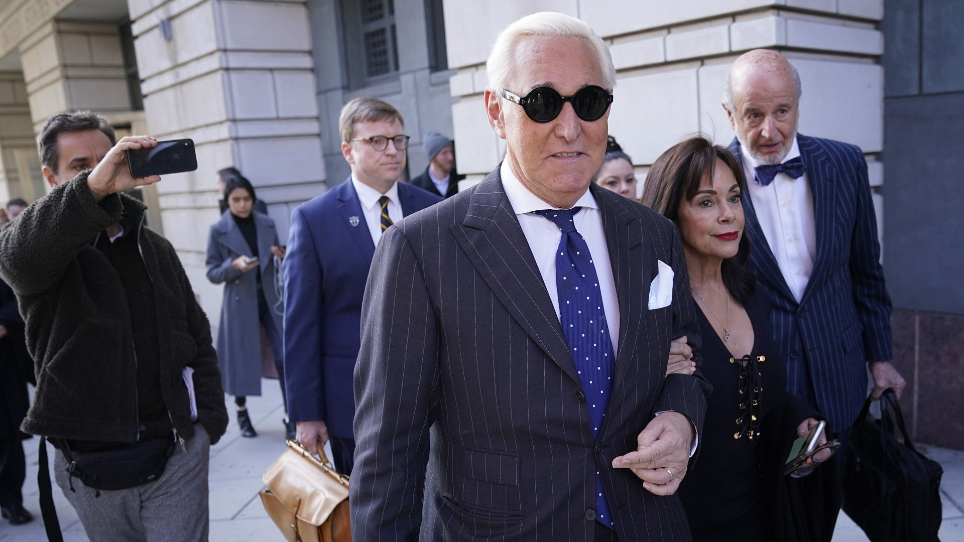 Former advisor to U.S. President Donald Trump, Roger Stone, departs the E. Barrett Prettyman United States Courthouse with his wife Nydia after being found guilty of obstructing a congressional investigation into Russia's interference in the 2016 election on November 15, 2019 in Washington, DC. (Credit: Win McNamee/Getty Images)