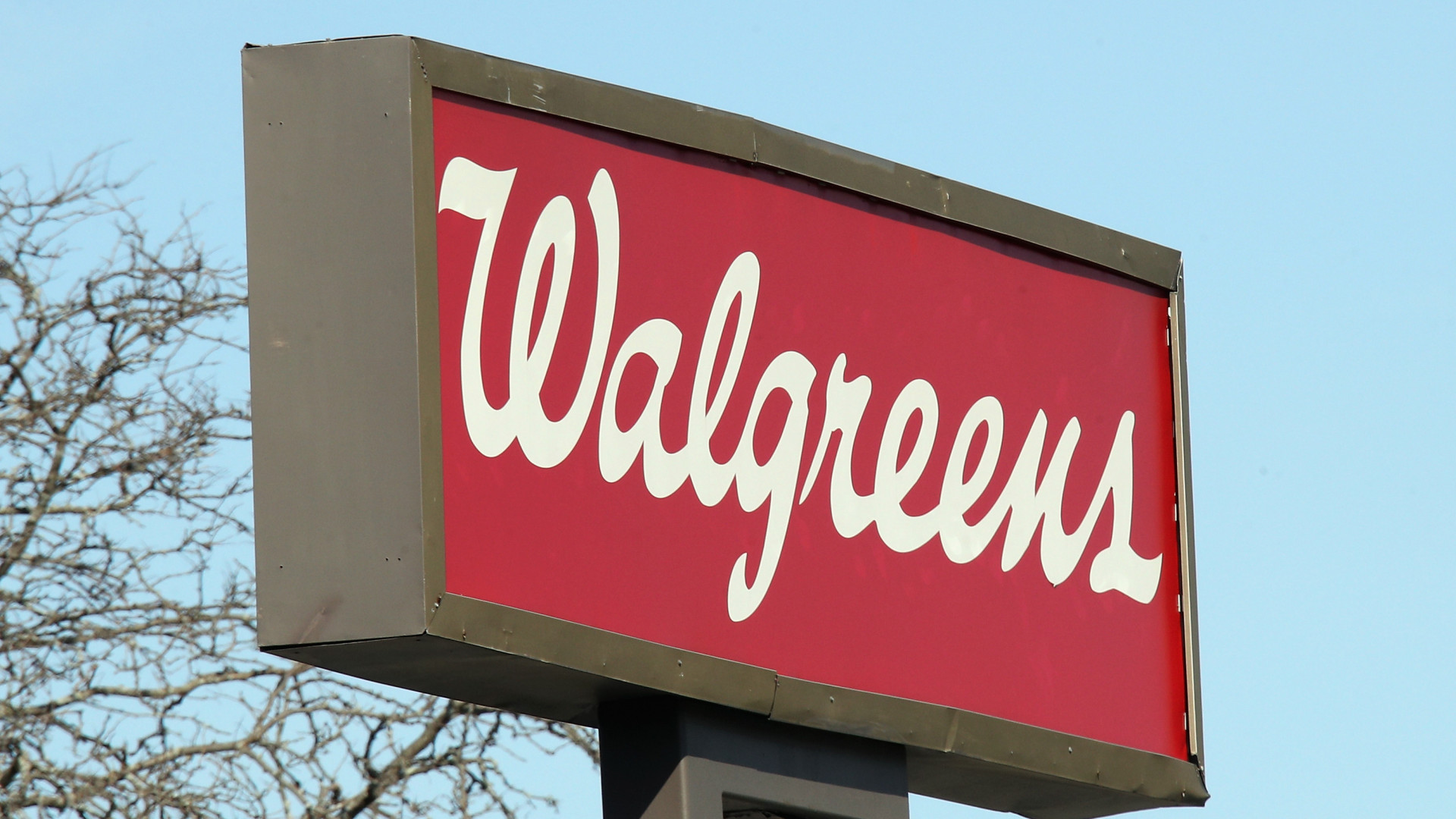 A Walgreens sign is seen on March 18, 2020, in Hicksville, New York. (Credit: Bruce Bennett / Getty Images)