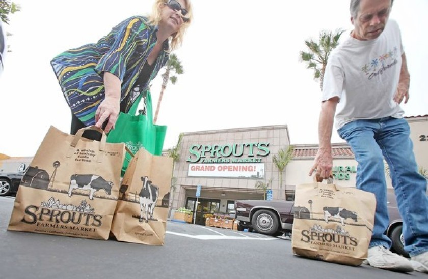 Shoppers are seen outside the Sprouts Farmers Market in Costa Mesa in this file photo. (Credit: Don Leach / Los Angeles Times)