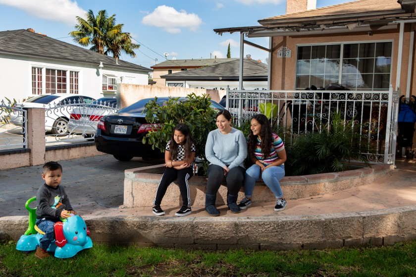 Valeria, 8, and Keyla, 12, enjoy their 2-year-old brother, Carlos, but he can be distracting, says their mother Norma Quijas.(Gabriella Angotti-Jones/Los Angeles Times)