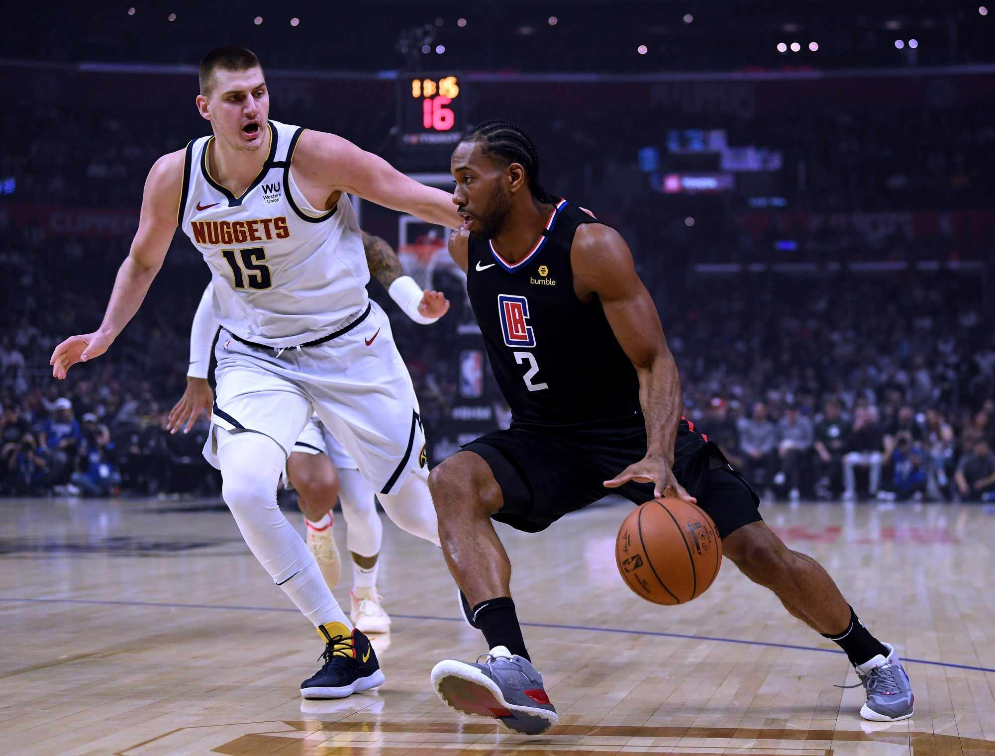 Kawhi Leonard #2 of the L.A. Clippers drives to the basket on Nikola Jokic #15 of the Denver Nuggets during the first half at Staples Center on Feb. 28, 2020, in Los Angeles. (Harry How/Getty Images)