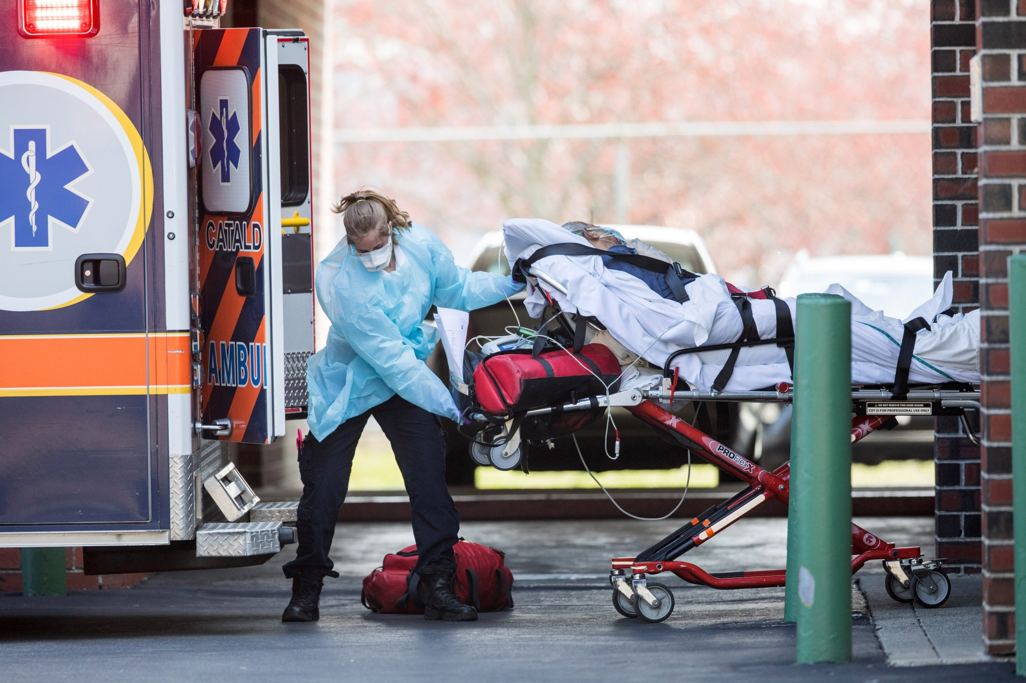 First responders load a patient into an ambulance from a nursing home where multiple people have contracted COVID-19 on April 17, 2020 in Chelsea, Massachusetts. (Scott Eisen/Getty Images)