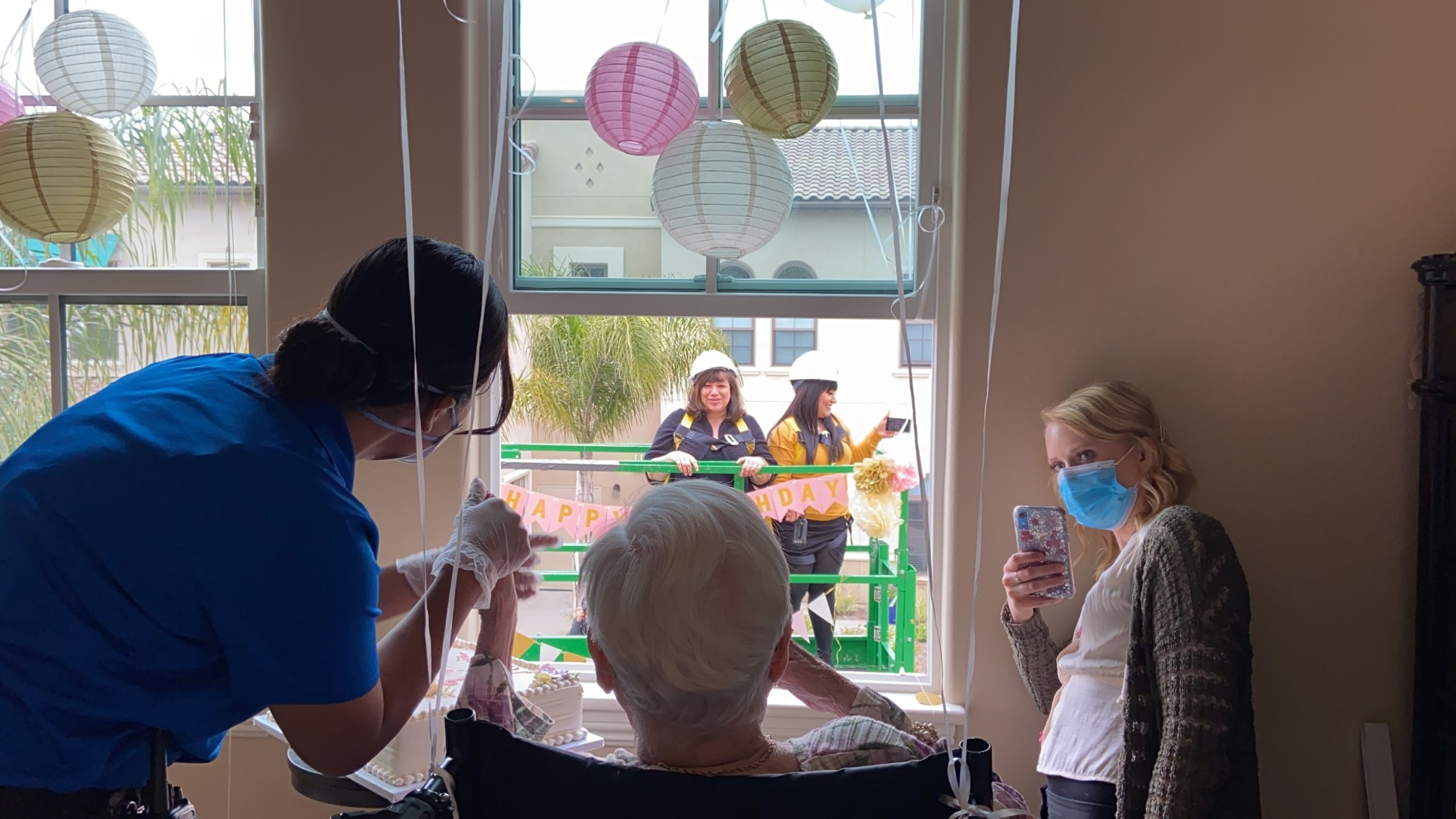 Lucy and Amber Cavazos visit Margie Jones on her 91st birthday at The Kensington Redondo Beach, on April 7, 2020. (The Kensington Redondo Beach)