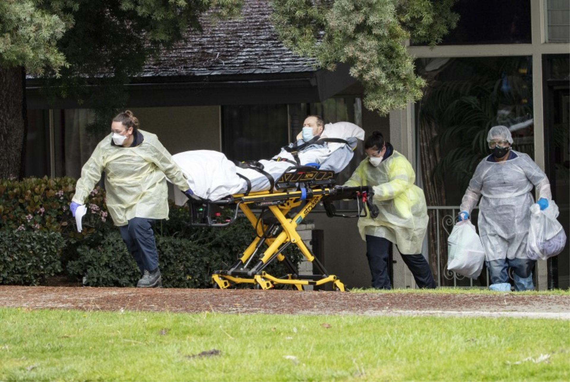Patients are moved from the Magnolia Rehabilitation and Nursing Center in Riverside after 13 staff members fail to show up for work.(Gina Ferazzi / Los Angeles Times)