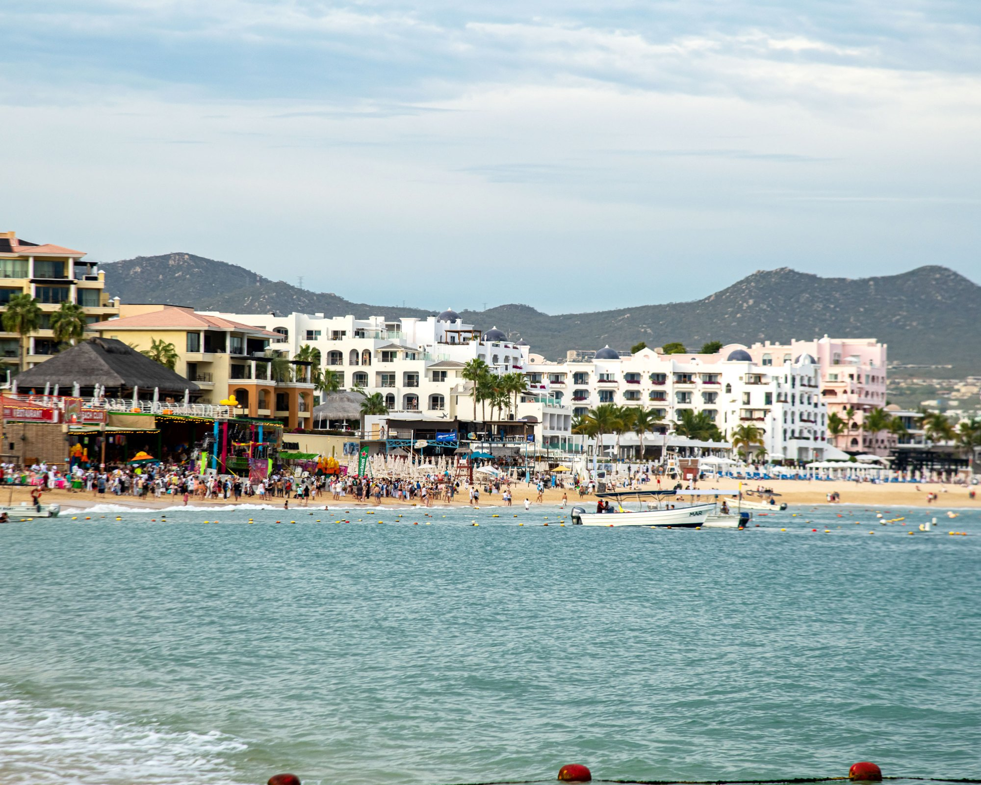 People walk on the beach in Cabo San Lucas, Mexico, on March 23, 2020. (Shutterstock)