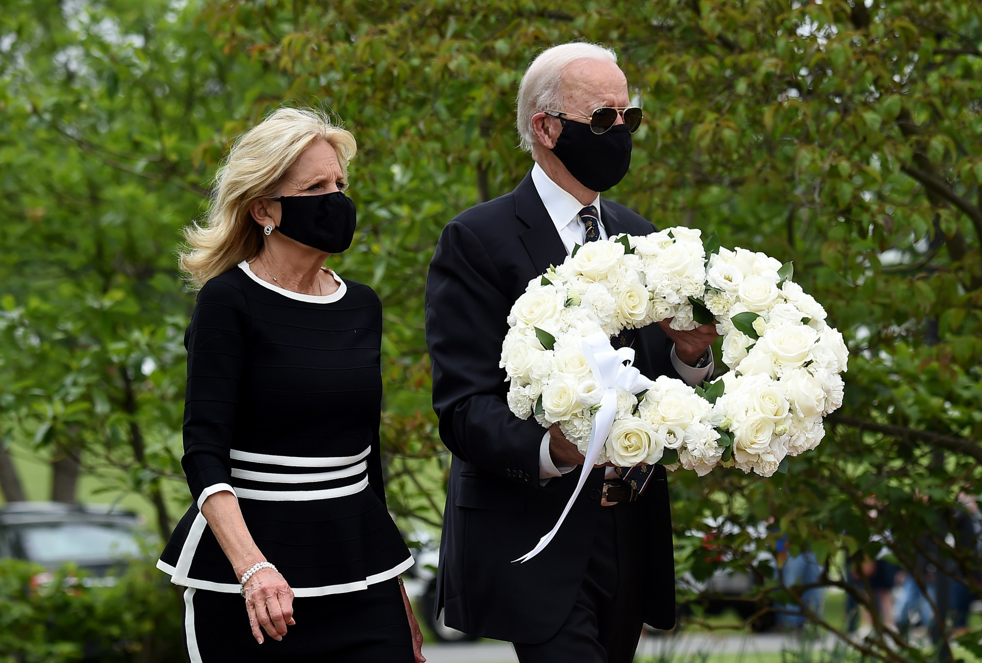 Joe and Jill Biden pay their respects to fallen service members on Memorial Day at Delaware Memorial Bridge Veteran's Memorial Park in Wilmington on May 25, 2020. (Olivier DOULIERY / AFP via Getty Images)