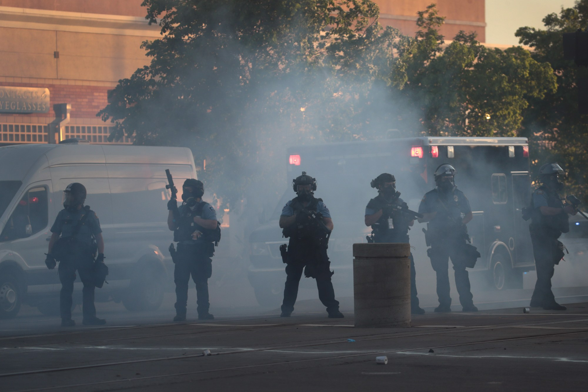 Police officers keep watch in a haze of tear gas during a protest on May 28, 2020 in St. Paul, Minnesota. (Scott Olson/Getty Images)